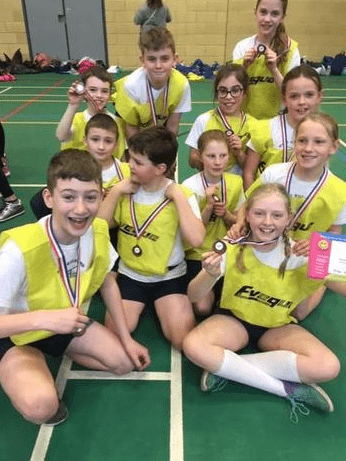 Athletics squad with medals